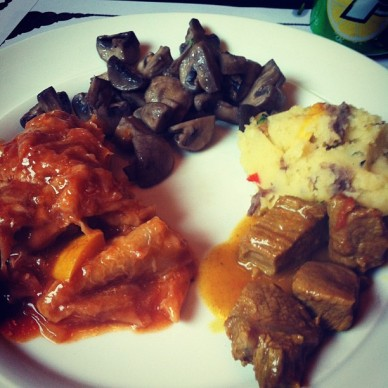Buttered mushrooms, mashed potato, beef cooked in some kind of sauce and chicken pot pie.